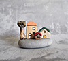 Click here for more information about Miniature Houses on Beach Stone  Random
